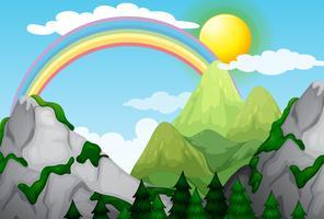 Eine wunderschöne Berglandschaft und ein Regenbogen vektor