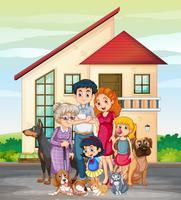 Familjemedlem framför huset