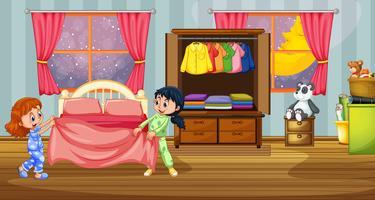 Flickor i pyjamas på sovrummet