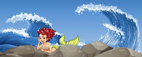 Meerjungfrau auf dem Felsen vektor