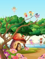 Fairies som flyger i trädgården