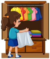 Mädchen, das Kleidung in Wandschrank weglegt vektor