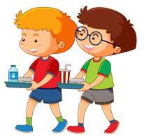Två pojkar håller fack med mat