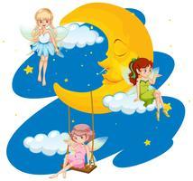 Tre älvor som flyger i himmel vid nattetid