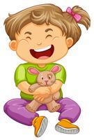Kleines Kleinkindmädchen mit Häschenpuppe