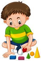 Junge, der mit Formblöcken spielt vektor