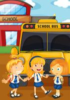 Tre studenter i uniform av skolbussen