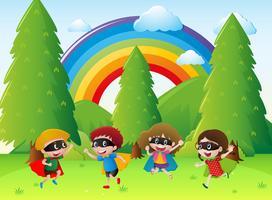 Barn spelar hjälte i parken vektor