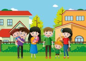 Människor i familjen på gräset