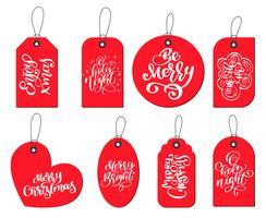 Vektor röda etiketter taggar samling med kalligrafi bokstäver citat Njut av xmas, Var glad, o helig natt, Glatt ljus, God jul, Ho-ho-ho