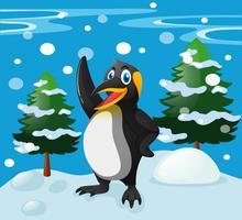 Söt pingvin som står på snöfältet