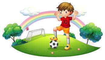 En pojke på ett fotbollsplan vektor