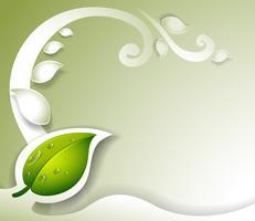 Ett gråfärgat brevpapper med ett grönt blad