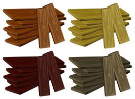 Fyra högar av trä i olika färger