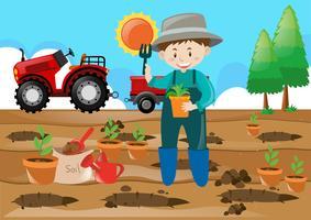 Bauernhofszenenlandwirt, der Baum auf dem Gebiet pflanzt