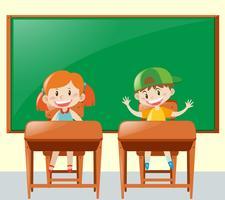 Två elever i klassrummet