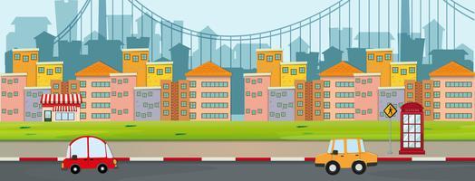 Scen med byggnader och bilar på väg