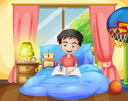 En pojke skriver på sängen