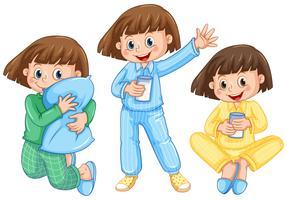 Glückliches Mädchen auf unterschiedlichen Pyjamas