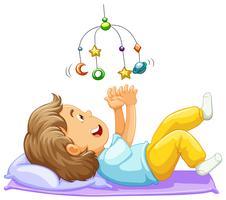 Pojke litet barn leker med mobil leksak vektor