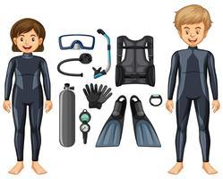 Dykare i våtdräkt och olika utrustning