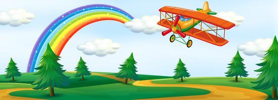Ein Flugzeug fliegt über die Natur