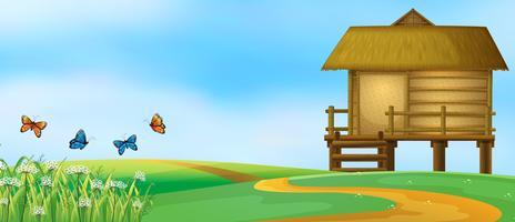 Holzhütte in der Naturlandschaft vektor