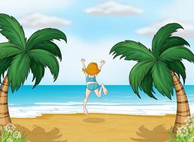 En tjej njuter av sommaren på stranden