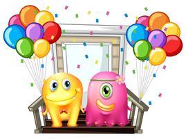 Två monster och färgstarka ballonger vektor