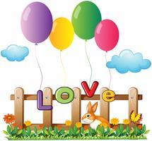Fyra flygande ballonger nära trästaket med en kanin