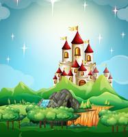 Scen med slott och skog
