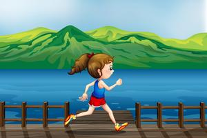 Ein Mädchen läuft am Hafen