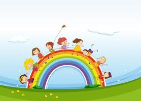 Kinder stehen über dem Regenbogen vektor