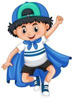 Glad pojke spelar hjälte