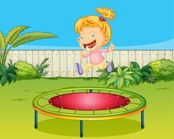 Ein Mädchen springt auf ein Trampolin