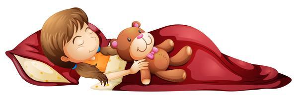 En ung tjej sover lugnt med sin leksak