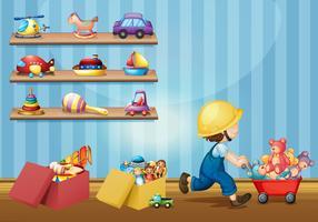 Junge, der mit Spielwaren im Raum spielt