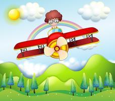 Ein Junge, der in einem roten Flugzeug reitet vektor