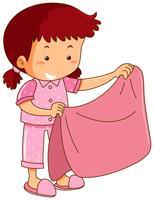 Mädchen in den rosa Pyjamas, die rosa Decke halten