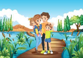 Familj stående på bron