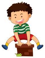 Glad pojke hoppar över tegelstenen