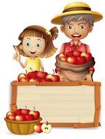 Bonde med äpple på träbalk