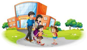 Familjemedlemmar framför skolan