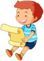 Liten pojke läsning papper