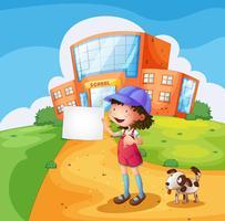 Ett barn med ett papper som står framför skolan