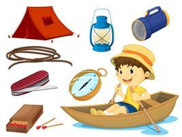en pojke och olika föremål för camping vektor