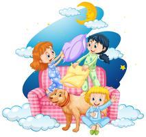 Tre tjejer och hund på soffan