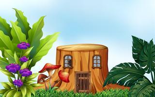 Baumstumpf mit Fenstern und Tür