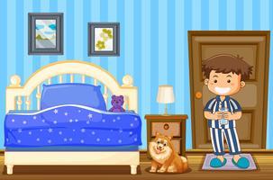 Junge und Hund im blauen Schlafzimmer