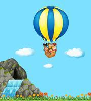 Barn som rider på ballong i himlen